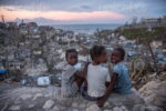 "On 13 October 2016 in Jérémie, Haiti, Mylove Théogène, 8, sits with other girls near her home.  Mylove's family stayed in their home on a hilltop until their home collapsed around 5:00am on the night Hurricane Matthew struck Haiti. Then, the family then moved to a school house for shelter.  ""I thought I was going to die.  I thought my family would all die"" said Mylove.  The family of five lost their father in February 2016, when he fell from a tree while collecting fruit for the family to eat. ""When I grow up I want to go to school"" Mylove remarks as a second-grader who has not been to school at all in 2016.  More than one week after Hurricane Matthew, as schools re-open across the country, more than 100,000 children will be missing out on learning after their schools were either damaged or converted into shelters.  Hurricane Matthew passed over Haiti on Tuesday October 4, 2016, with heavy rains and winds. While the capital Port au Prince was mostly spared from the full strength of the class 4 hurricane, the western area of Grand Anse, however was in the direct path. The cities of Les Cayes and Jeremie received the full force sustaining wind and water damage across wide areas. Coastal towns were severely damaged as were many homes in remote mountainous regions. International relief efforts are underway to provide food water and shelter to the people affected by the storm.  An estimated 500,000 children live in the Grande Anse Department and Grand South Department in southern Haiti, the areas worst hit by Hurricane Matthew.  UNICEF had prepositioned emergency supplies with national authorities to reach up to 10,000 people.  On 8 October, six water trucks arrived in Jeremie and Les Cayes, the respective capital cities within the Departments.  Additional water and sanitation supplies, such as water purification tablets, water bladders and plastic sheeting, have been dispatched to the most affected departments in the westernmost tip of Haiti.  As of 10 October, UNICEF delivered blankets, buckets, water purifying equipment and cholera diagnostic kits.  UNICEF is working to reinforce good hygiene practices, especially in temporary shelters, in order to minimize the outbreak of disease.  An investigation is underway to confirm the areas affected by cholera, and to determine the cross-over with hurricane-affected areas."